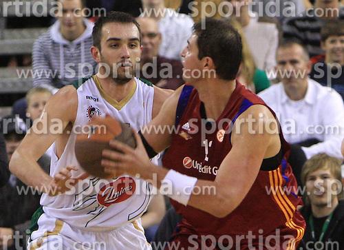 Mirza Begic (15) and Primoz Brezec (12) at basketball match of 3rd Round of Euroleague between KK Union Olimpija (SLO) and Lottomatica Roma (ITA), in Arena Tivoli, Ljubljana, Slovenia, on November 6, 2008. Lottomatica  won the match 78:67.