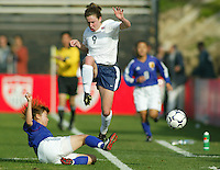 Heather O'Reilly jumps over a sliding Japanese player during a 0-0 tie in San Diego, Calif., January 12, 2003.