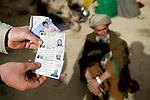 Fake ID cards found by the 82nd Airborne in Kshahah Lakhchack, Kandahar province, Afghanistan on Monday, March 26, 2007.