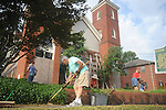 Charles Clark and members of the Master Gardeners maintain the lawn at The Belfry in Oxford, Miss. on Wednesday, July 14, 2010.