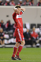 Brian McBride (20) of the Chicago Fire reacts to a missed scoring opportunity during the first half of a Major League Soccer match between the New York Red Bulls and the Chicago Fire at Red Bull Arena in Harrison, NJ, on March 27, 2010.
