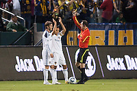 LA Galaxy players Landon Donovan & David Beckham viewing the yellow card from Referee Paul Ward. The LA Galaxy defeated the Philadelphia Union 1-0 at Home Depot Center stadium in Carson, California on  April  2, 2011....