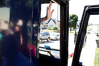 Republican presidential hopeful Rep. Michele Bachmann (R-MN) waves from her campaign bus on Wednesday, July 20, 2011 in Norwalk, IA.