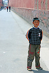 "Asia, China, Beijing. Young boy stands in scene of the ""Last Emperor"" at the Forbidden Palace in Beijing;"