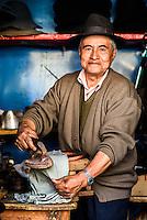 A man making a hat in Sucre, Bolivia.