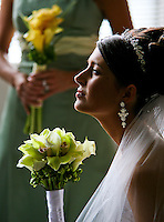Krystal holds her bouquet as she waits with her bridesmaids for the start of her wedding ceremony. (Photo by Scott Eklund/Red Box Pictures)