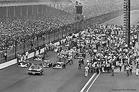 INDIANAPOLIS, IN: Following the pace car driven by actor James Garner, the field begins to roll away from the grid before the start of the Indianapolis 500 on May 29, 1977, at the Indianapolis Motor Speedway.