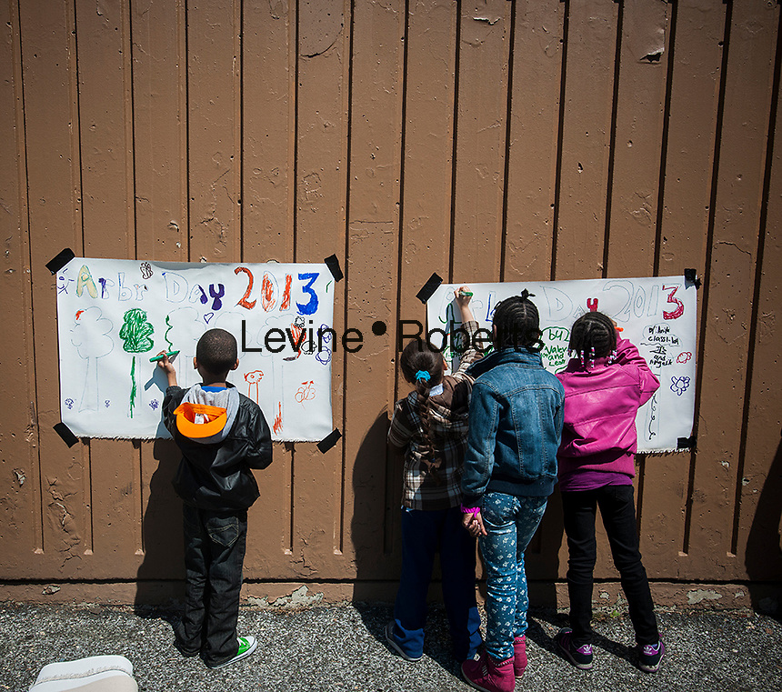 First and second graders from neighborhood schools celebrate Arbor Day in Herbert Von King Park in the Bedford-Stuyvesant neighborhood of Brooklyn in New York on Friday, April 26, 2013. The students planted trees,  painted murals, played recycling games and learned about the importance of trees in keeping the air we breathe clean. (© Richard B. Levine)
