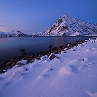 Sørfjellet mountain peak rising over winter coastline near Henningsvær, Austvågøy, Lofoten Islands, Norway