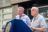 New York Mayor Bill de Blasio, left, and NYPD Commissioner William Bratton brief the media about improvements to police equipment on Monday, July 25, 2016 at the 84th Precinct in Brooklyn in New York. (© Frances M. Roberts)