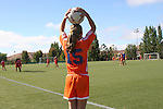 young girl soccer player waiting to resume game on the field