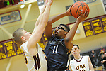 Eagle River's Jacob Thompson encounters resistance from Dimond's Sterling Retsleft.  Photo for the Star by Michael Dinneen