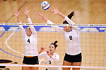 03 DEC 2011:  Amanda Konetchy (4) and Katie Habeck (8) of Concordia University St. Paul jump for a block against Cal State San Bernardino during the Division II Women's Volleyball Championship held at Coussoulis Arena on the Cal State San Bernardino campus in San Bernardino, Ca. Concordia St. Paul defeated Cal State San Bernardino 3-0 to win the national title. Matt Brown/ NCAA Photos