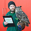 London Zoo<br /> Annual stocktake <br /> 2nd January 2014 <br /> London Zoo, Regent's Park,<br /> London, Great Britain <br /> <br /> <br /> Owls <br /> Max - Eagle Owl with keeper Jamie Pearce<br /> <br /> <br /> <br /> Photograph by Elliott Franks