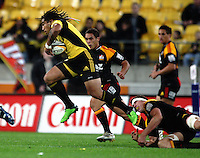 Hurricanes second five Ma'a Nonu leaps out of the tackle of Calum Retallick during the Super 14 rugby match between the Hurricanes and Chiefs at Westpac Stadium, Wellington, NewZealand on Saturday, 1 May 2010. Photo: Dave Lintott / lintottphoto.co.nz