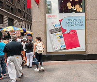 A back to school display is seen on the window of a Staples store in New York on Friday, August 5, 2016. Back-to-school is the second biggest shopping season. (© Richard B. Levine)