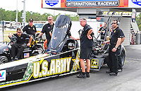 Jan. 17, 2012; Jupiter, FL, USA: Crew chief Mike Green (center) stands alongside NHRA top fuel dragster driver Tony Schumacher during testing at the PRO Winter Warmup at Palm Beach International Raceway. Mandatory Credit: Mark J. Rebilas-