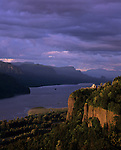 Columbia River Gorge National Scenic Area Crown Point State Scenic Corridor Crown Point with Vista House lookout and observatory sunset with dramatic light and storm clouds Oregon State USA