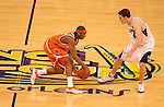 7 April 2003: Syracuse forward Carmelo Anthony (15) dribbles the ball upcourt against Kansas forward Nick Collison (4) during the Men's Division I Final Four Championships held at the Louisiana Superdome in New Orleans, LA. Syracuse University went on to defeat Kansas University 81-78 for the championship title. Photo by: Brett Wilhelm/NCAA Photos