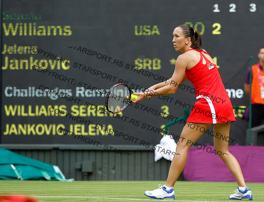 Olympic games London 2012.Tennis tournament.Jelena Jankovic SRB v Serena Williams USA.Jelena Jankovic returnes the ball.London, 28.07.2012..foto: Srdjan Stevanovic/Starsportphoto ©