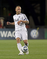 Vancouver Whitecaps FC defender Jay DeMerit (6) passes the ball. In a Major League Soccer (MLS) match, the New England Revolution defeated the Vancouver Whitecaps FC, 1-0, at Gillette Stadium on May14, 2011.