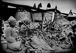 Buddha statues, coated with volcanic ash, have survive Mt. Merapi's worst eruption in over a century and the collapse of a protective roof which came down on them.  Near Borobudur, Java, Indonesia.