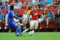 Tom Cleverley.Shavar Thomas (blue)..Kansas City Wizards defeated Manchester United 2-1 in an international friendly at Arrowhead Stadium, Kansas City, Missouri.