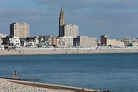Beach and city of Le Havre, Normandy, France. In the centre is the tower of the Eglise Saint-Joseph or St Joseph's Church, built 1951-58 as a memorial to the 5000 citizens of the town who died during the Second World War, designed by Auguste Perret, 1874-1954, and Raymond Audigier. Either side are the apartment blocks at Porte Oceane, completed 1956, also designed by Perret, who led the reconstruction of Le Havre in the 1950s, after the town was completely destroyed in WWII. The centre of Le Havre is listed as a UNESCO World Heritage Site. Picture by Manuel Cohen
