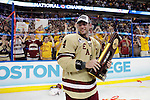 07 APR 2012:  Tommy Cross (4) of Boston College holds the trophy after defeating Ferris State University during the Division I Men's Ice Hockey Championship held at the Tampa Bay Times Forum in Tampa, FL.  Boston College defeated Ferris State 4-1 to win the national title.  Matt Marriott/NCAA Photos
