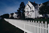 White picket fences and a house with an American flag make a traditional scene on Little Lake Street. Several historic homes keep the quaint feel of Americana in the small town of Mendocino.