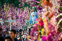"An altar with a statue of Virgin Mary is carried during the procession of the Flower & Palm Festival in Panchimalco, El Salvador, 8 May 2011. On the first Sunday of May, the small town of Panchimalco, lying close to San Salvador, celebrates its two patron saints with a spectacular festivity, known as ""Fiesta de las Flores y Palmas"". The origin of this event comes from pre-Columbian Maya culture and used to commemorate the start of the rainy season. Women strip the palm branches and skewer flower blooms on them to create large colorful decoration. In the afternoon procession, lead by a male dance group performing a religious dance-drama inspired by the Spanish Reconquest, large altars adorned with flowers are slowly carried by women, dressed in typical costumes, through the steep streets of the town."