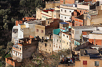 View of the town of Moulay Idriss, over rooftops of houses with flat roofs, Meknes-Tafilalet, Northern Morocco. The town sits atop 2 hills on Mount Zerhoun and was founded by Moulay Idriss I, who arrived in 789 AD and ruled until 791, bringing Islam to Morocco and founding the Idrisid Dynasty. It is an important pilgrimage site for muslims. Picture by Manuel Cohen