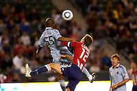 Chivas USA defender Jimmy Conrad (12) battles in the air with Sporting Kansas City forward Julio Cesar (55). Sporting KC defeated CD Chivas USA 3-2 at Home Depot Center stadium in Carson, California on Saturday March 19, 2011...