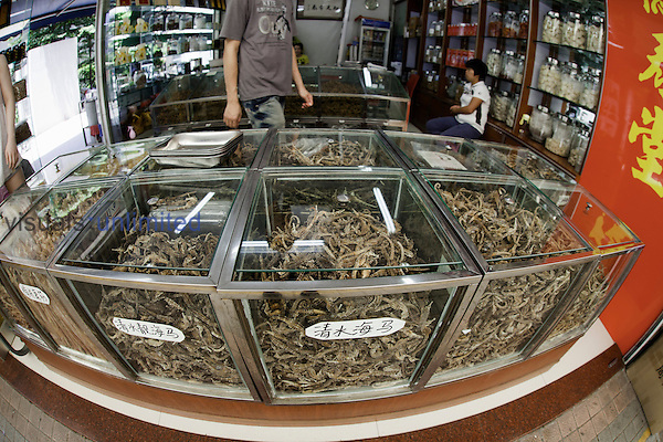 Glasses cases full of dried Seahorses for sale as aphrodisiacs at a traditional medicine shop in Guangzhou, China.