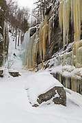 Pitcher Falls during the winter months in Albany, New Hampshire USA. This waterfall is located next to Champney Falls along Champney Falls Trail.