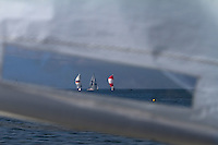 Looking through an Optimist sail at the racing on day 3 of Match Race Germany 2010. World Match Racing Tour. Langenargen, Germany. 22 May 2010. Photo: Gareth Cooke/Subzero Images/WMRT