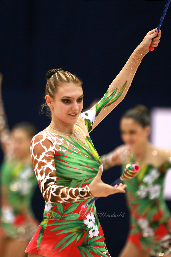 Katerina Pisetsky recatches clubs with Israel rhythmic group  (clubs+hoop)  at 2006 Mie World Cup Finale of rhythmic gymnastics on November18, 2006.<br />