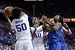 UK forward/center Azia Bishop defends the ball while forward Brittany Henderson guards during the first half of the women's basketball game v. Depaul University in Rupp Arena in Lexington, Ky., on Sunday, December 7, 2012. Photo by Genevieve Adams | Staff