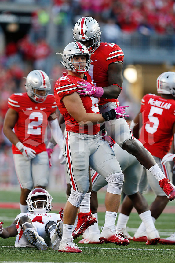 Ohio State Buckeyes defensive end Sam Hubbard (6) and Ohio State Buckeyes defensive end Jalyn Holmes (11) celebrate a yardage loss  in the fourth quarter at Ohio Stadium October 8, 2016.(Dispatch photo by Eric Albrecht)