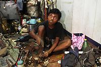 A boy working in a store in the Chandni Chowk electronics market in Kolkata, India. November, 2013