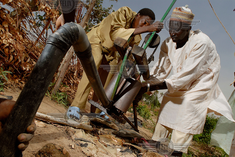Farmers on an IFAD-supported irrigation project pump water from a borehole well in order to irrigate their land. The International Fund for Agricultural Development (IFAD), a specialised UN agency established to finance agricultural projects in developing countries, runs several irrigation programmes in the dry sub-Saharan Sahel region.