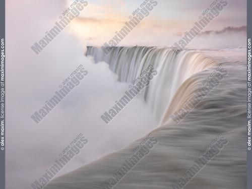 Brink of Niagara Falls Canadian Horseshoe beautiful sunrise scenery in soft light pastel colors, wintertime scenic. Niagara Falls, Ontario, Canada.