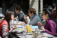 Diners eating outside the Fountain Bistro in redeveloped Xintiandi, Huang Pi Road, Shanghai, China