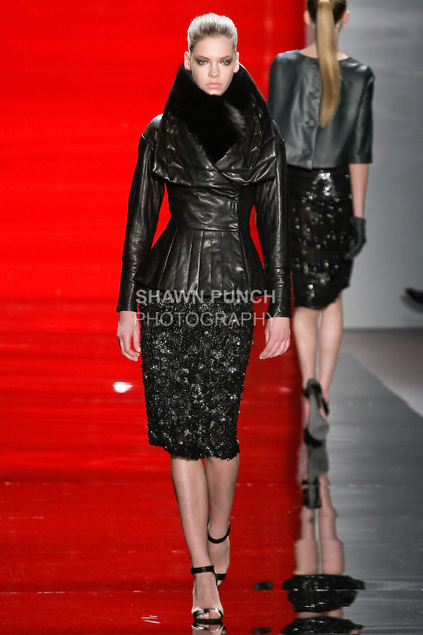 Valeriya walks runway in a ebony trapunto-stitched fitted leather jacket with peplum and ebony 3-dimensional pinwheel embroidered skirt, from the Reem Acra Fall 2012 Feminine Power collection fashion show, during Mercedes-Benz Fashion Week New York Fall 2012 at Lincoln Center.