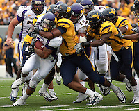 The WVU defense swarms an East Carolina running back. The WVU Mountaineers defeated the East Carolina Pirates 35-20 at Mountaineer Field at Milan Puskar Stadium, Morgantown, West Virginia on September 12, 2009.