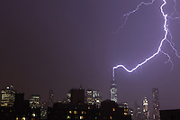 Lightning strikes One World Trade Center during a heavy thunderstorm over Manhattan on July 23, 2014