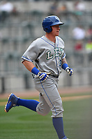 First baseman Chris DeVito (34) of the Lexington Legends runs toward first in a game against the Columbia Fireflies on Sunday, April 23, 2017, at Spirit Communications Park in Columbia, South Carolina. Lexington won, 4-2. (Tom Priddy/Four Seam Images)