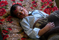 """Hilla, Iraq, April 2, 2003.Hilla Hospital, Hader Ahmed Jassim, 7, was wounded in his house in """"Nader 3"""" village by a US cluster bomb. Hader suffer from severe concussion and his shell-shocked."""