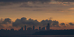 Seattle silhouetted in the morning sunlight.  Jim Bryant Photo. ©2013. All Rights Reserved.
