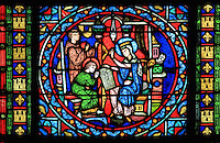 The education of Saint Louis by his mother Blanche of Castile, stained glass window, 1871, in the apse of the Collegiale Notre-Dame de Poissy, a catholic parish church founded c. 1016 by Robert the Pious and rebuilt 1130-60 in late Romanesque and early Gothic styles, in Poissy, Yvelines, France. The windows of the apse tell the story of Saint Louis or King Louis IX of France, born in Poissy in 1214. The Collegiate Church of Our Lady of Poissy was listed as a Historic Monument in 1840. Picture by Manuel Cohen